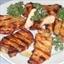 Grilled Pork Steaks with Lemon Butter Sauce