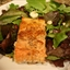 Seared Salmon Over Mixed Greens with Raspberry Vinaigrette & Candied Pecans